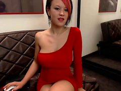 Sexy alt redhead wearing a red dress has a smoke and chats