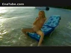 Amateur babe on beach stripping and fingering