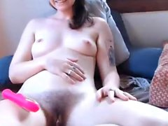 Webcam girl fingering her hairy twat