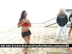 Horny brunette pornstar outside on the beach lifting weights