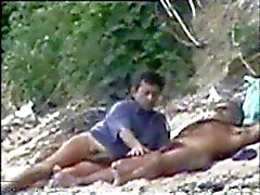 Gay caught playng on the nude beach