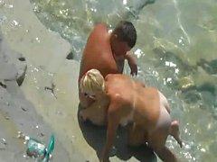 Adventurous couple have sex on the beach