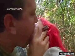 Foxy redhead babe sucking on a hard cock in the woods