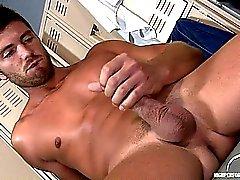 Etienne Pauliac jerks off his uncut cock in the locker room