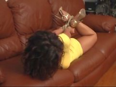 Nikki hogtied on couch