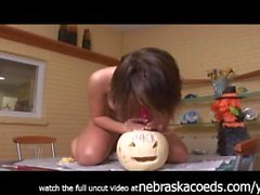 gorgeous chick fucking a pumpkin with a dildo taped to the top bizarre