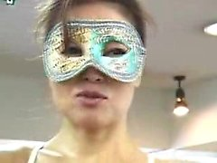 Masked Japanese lady shows off her amazing worked out body