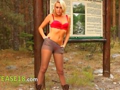 Blonde babe in pantyhose pose forest