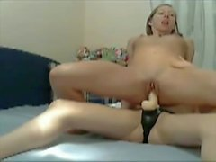 Two hot chicks lick in a 69 and fuck with a strap-on