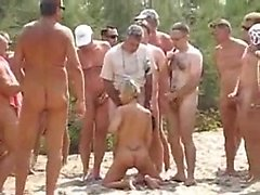 Spouse utilized by 20 visitors at beach that was naked