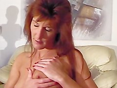 Skinny Mature Lady Rubs Her Titties With Lotion