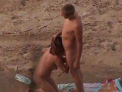 Voyeur. Fellatios on beach