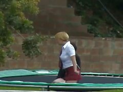 Two naughty girls jump on trampoline