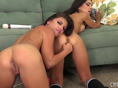 Lesbian babes Trinity and Adriana check each other out and foot fuck