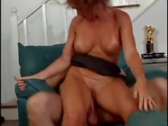 Sexy red head milf slut has sweaty sex with a hot young guy