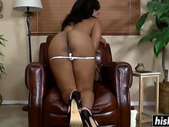Black chick plays with her feet