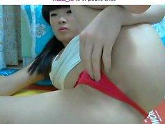 Hot Oriental girl in red panties sends her fingers pleasing