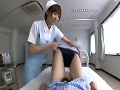 Busty Japanese nurse with a pretty smile pleases a hard sha