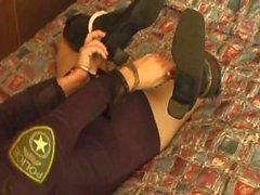 booted cop playing with cuffs