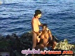 African ebony girl in interracial threesome on seashore