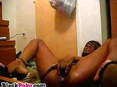Horny ebony toying her pussy with big dildos