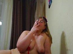 pretty fatty, smokes and shakes tits)