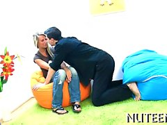 Chap kisses lips of legal age teenager girl undressing her.