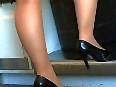Candid shoe play of stewardess in tan pantyhose