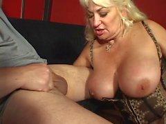 Huge racked blonde mature lingerie slut sucks cock and smokes cigarette