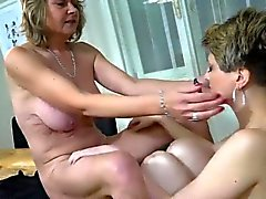 Young lady fingering sexy mature on the table