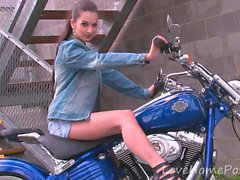 Hot motorcycle babe strips for the camera