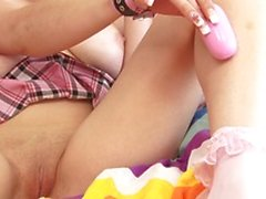 Sexy schoolgirl wearing a miniskirt masturbates solo with a toy