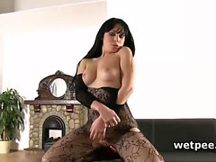 Luna Ora in sexy pantyhose plays with pussy