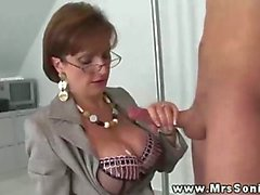 Mrs sonia gets cum over her giant tits after tugging dick