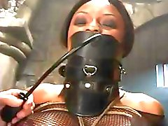 Busty ebony gets tied up and tortured in this hot BDSM clip
