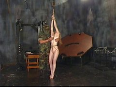 Blonde bitch gets roped to the ceiling and spanked hard by masked thug