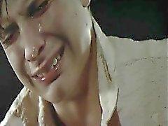 Jennifer Jason Leigh going topless at a bar, stumbling