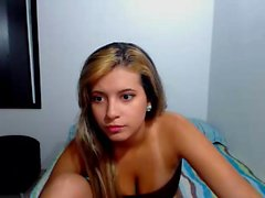 Cute blonde with nice tits is chatting on her live cam and