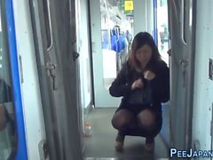 Asian pissing on train