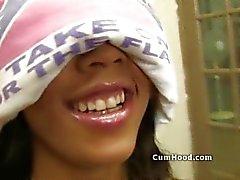 Blindfolded black teen fed white cocks