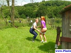Ginger piss babe gives goldenshower outdoors