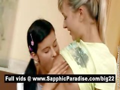 Sensual brunette and blonde lesbians kisisng and licking nipples and having lesbian love