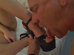Brunette chick uses a strap-on on a guy