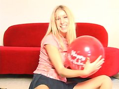 Seductive blonde camgirl with big hooters Allie has fun with balloons