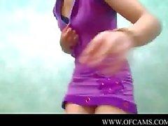 Carolinne masturbates for the camera em