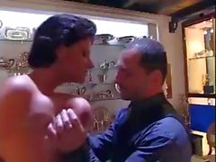 Mature Italian brunette with big tits gets hammered in the showroom