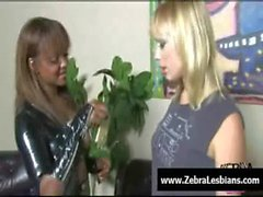 Zebra Lesbians - Sexy ebony lesbians fuck with strap-on toy 01