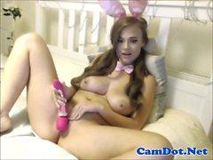 Webcam girl toying vibrator on her clit