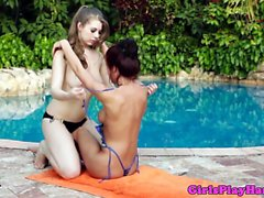 Teen lesbian beauties play with toys outdoor