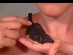 Hot girl swallows huge gummy rat and shows her.